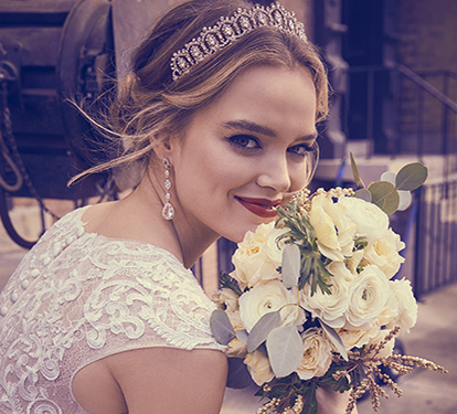 Smiling bride holding bouquet of flowers