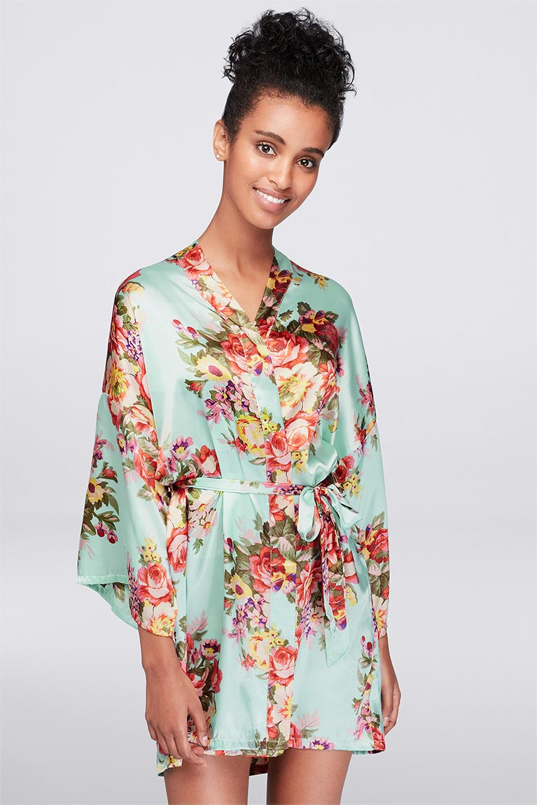 Woman wearing a short floral robe